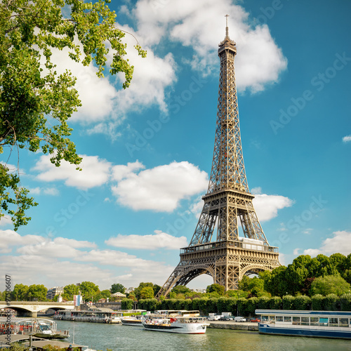 Eiffel Tower and blue sky, Paris, France. View of Seine river in summer. Fototapete