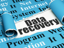 Data Concept: Black Text Data Recovery Under The Piece Of  Torn Paper