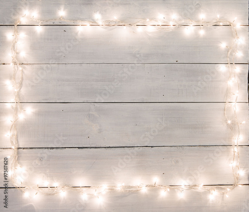 Christmas lights on white painted wooden background with copy sp Wall mural