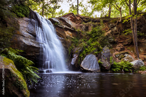 Beautiful Waterfall. Serene Tranquil Landscape with Picturesque Copy Space.