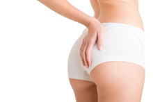 Woman Examining Her Buttocks For Cellulite