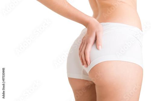 Valokuvatapetti Woman Examining Her Buttocks for Cellulite