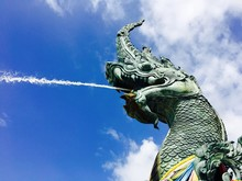 The Great Serpent With Water From Mouth Sculpture Blue Sky