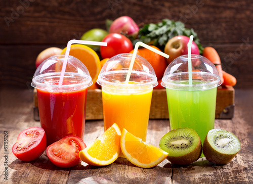 Staande foto Sap Fresh juices with fruits and vegetables