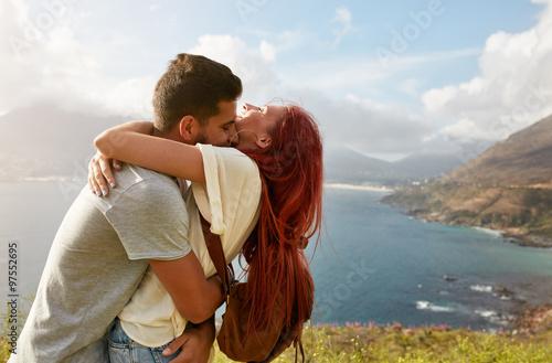 Fotografia  Loving young couple embracing outdoors