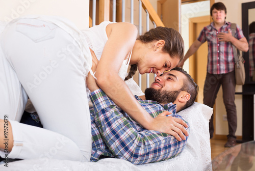 Leinwand Poster Husband watching how partner is cheating