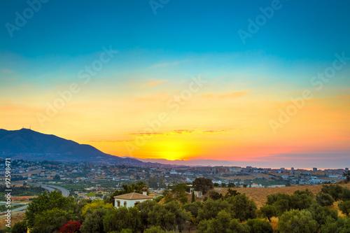 Fotografia Beautiful Sunset Over Mountain, Mediterranean sea and town Mijas