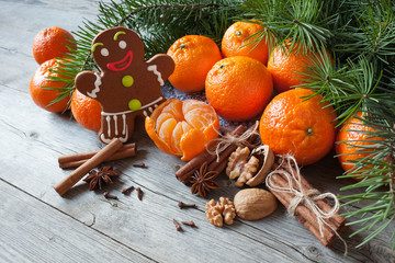 Christmas table with tangerines , gingerbread and fir branches