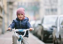 Cute Little Boy On Bike.