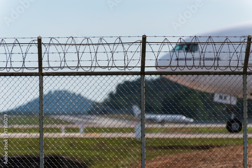 7b36e62d7e50 Airport fence and air plane behind - Buy this stock photo and ...