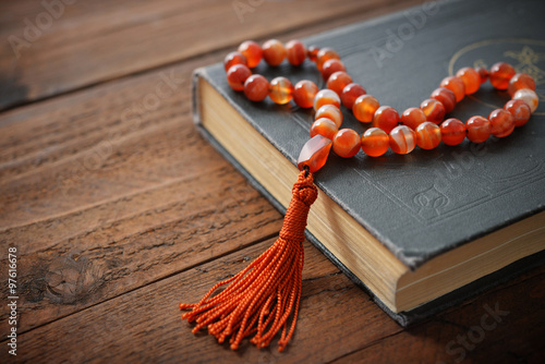 Photo  Holy Quran with beads