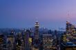 manhattan skyline at dusk seen from a rooftop of manhattan new york city
