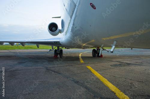 Fototapeta shiny fuselage jet passenger plane against the bright blue sky obraz na płótnie