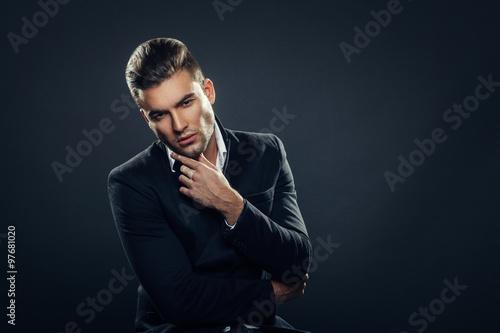 Portrait of handsome man in a studio on a dark background Wallpaper Mural