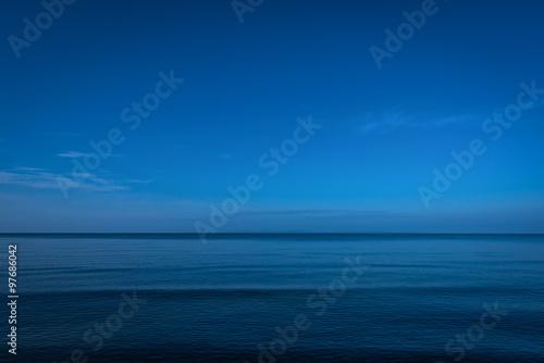 Poster Zee / Oceaan Calm ocean in twilight