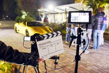Operator Holding Clapperboard ...