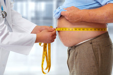 Doctor Measuring Obese Man Stomach.