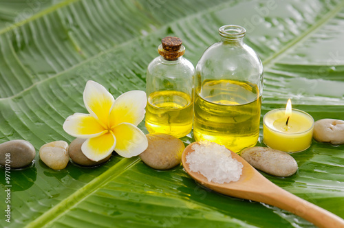 Staande foto Spa Spa set on banana leaf with white pile of salt in spoon