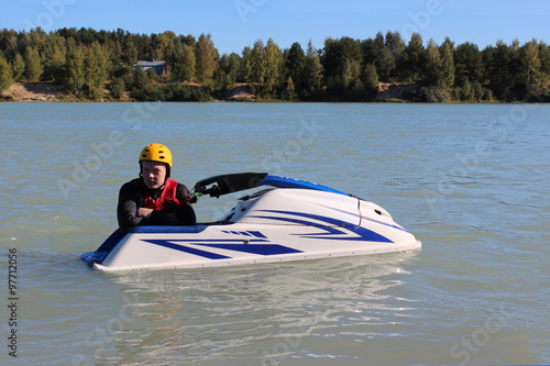 Poster Nautique motorise Young man near his jet ski.