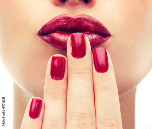 Poster Manicure Beautiful model shows red manicure on nails. Red lips .Luxury fashion style, manicure nail , cosmetics and makeup .