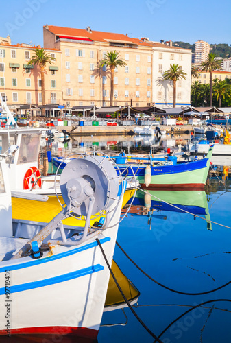 Photo Stands Nice Small colorful wooden fishing boats in Ajaccio