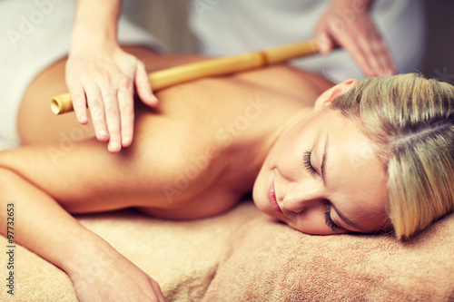 Fototapeta close up of woman lying and having massage in spa obraz