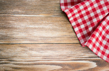 Red Picnic Cloth On Wooden Background.Napkin Tablecloth On Old W