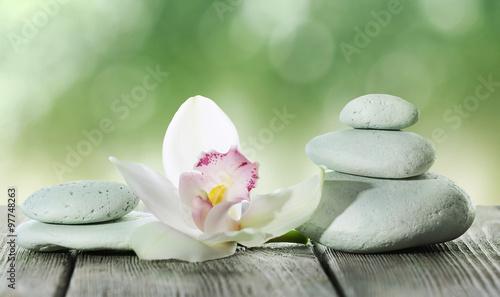 Spa stones on table,  on gr...