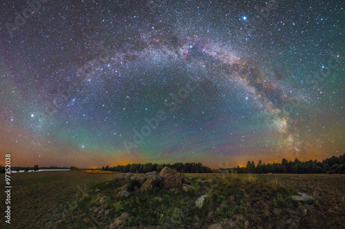 Photo Stands Night Bright Milky Way under the rocks