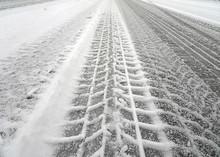 Tire Tracks On A Snow