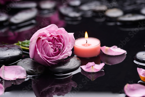 Fotobehang Spa Beautiful pink rose with candle and therapy stones