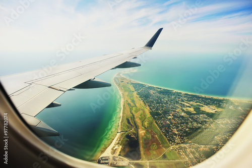 Looking through window aircraft, landing to Copenhagen airport Kastrup. - 97782074