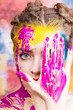 Portrait of beautiful young woman with paint on face