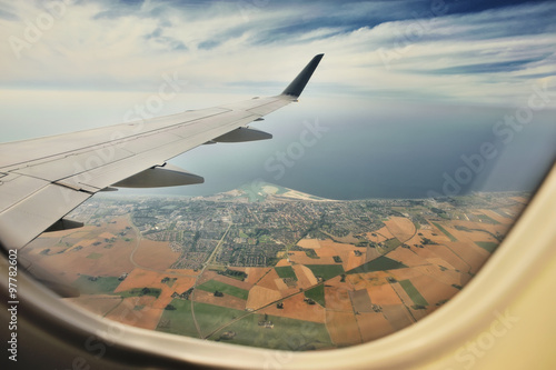 Looking through window aircraft, landing to Copenhagen airport Kastrup. - 97782602