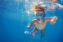 Underwater Kid In Swimming Pool With Mask.