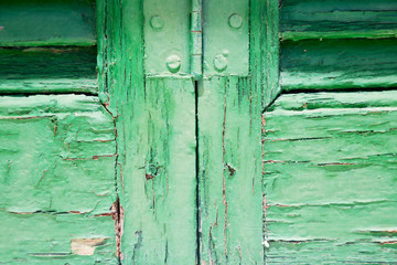 in the old wall a hinged window green wood