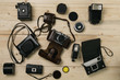 Old cameras on wooden board