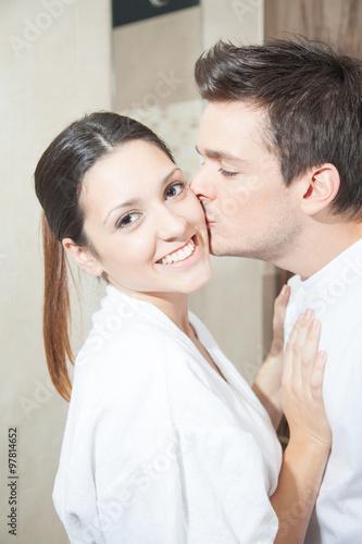 Man Kissing His Woman In Bathroom