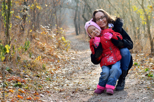 Staande foto Jogging Beautiful young woman with a child. Family photo.