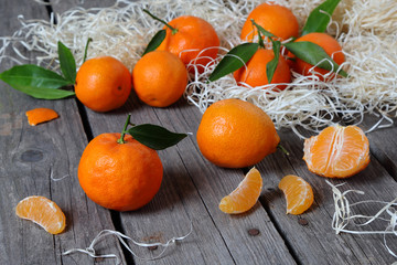 Tangerines on the gray wooden table