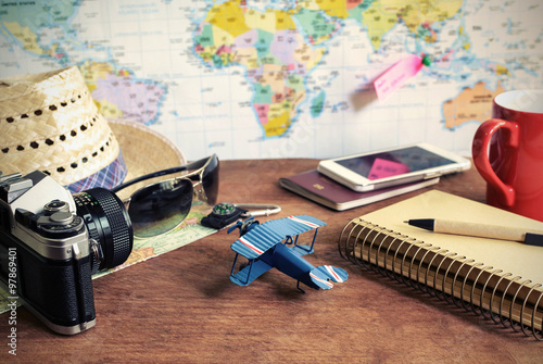 Travel and vacation accessories on wooden background