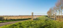 Closed Iron Gate In A Rural Landscape