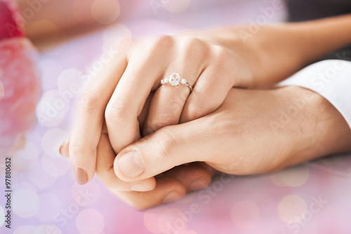 Aluminium Prints Manicure close up of couple hands with engagement ring
