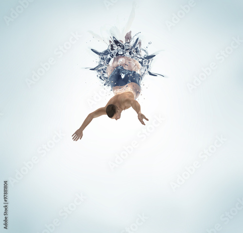 man diving into water isolated on white Wall mural