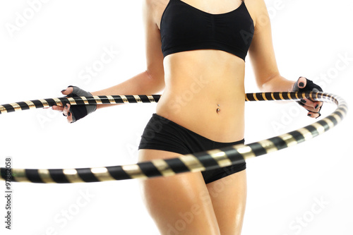 Obraz Koło hula hop, sposób na płaski brzuch. - fototapety do salonu