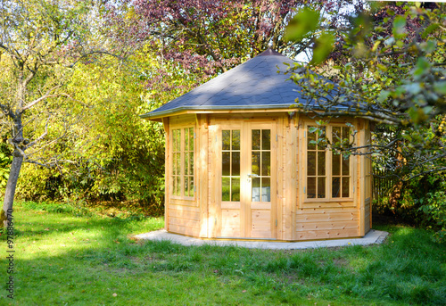 Wooden garden pavillion in beautiful light Canvas Print