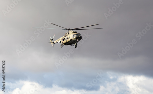 Russian army Mi-8 helicopter in action against cloudy sky Canvas Print