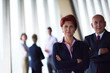diverse business people group with redhair woman in front