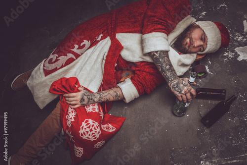 Fotografie, Obraz  Drunk man in santa's clothes.