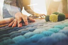Interior Designer Hand Chosing Carpet Sample With Blank New Mode